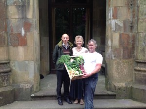 Steve with Patrick and Claire Mansel-Lewis with their weekly delivery of fresh vegetables